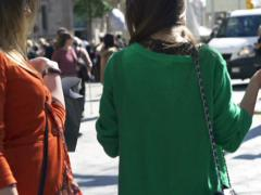 Women turning to the camera on the street, slow motion shot at 240fps - stock footage