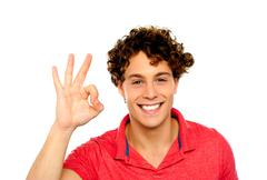 Curly hair guy gesturing excellence sign Stock Photos