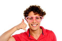 Boy posing with heart shape eye-wear - stock photo