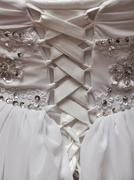 Detail of wedding dress with white lace and gems Stock Photos