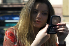 Woman improving makeup in street cafe, steadycam shot Stock Footage