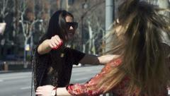 Women meeting on the street, slow motion shot at 120fps, steadycam shot Stock Footage