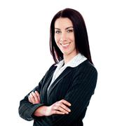 Stock Photo of Businesswoman posing with crossed arms