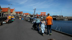 Family walking in a harbor Stock Footage