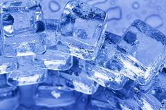 Ice cubes in blue background Stock Photos