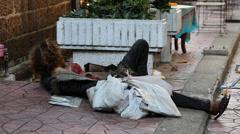 Woman sleeps on the street in central Bangkok on Khao San Road. Thailand Stock Footage