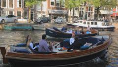 Mid shot of people in boat on Amsterdam water channel Stock Footage