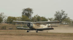 Antonov An-2R taking off from airfield Stock Footage