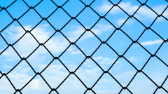 timelapse of steel cage with blue sky and cloud moving - stock footage