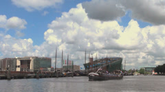 Wide shot of a barge on Amstel River in Amsterdam, the Netherlands Stock Footage