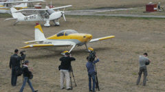 Several cameraman shooting yellow aircraft Van's Aircraft RV-7 before the flight Stock Footage