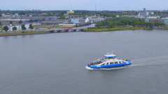 Wide shot of motorboat sailing on Amstel River in Amsterdam - stock footage