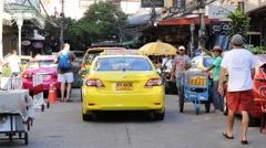 Taxis and tuk tuk on the Khao San Road. Bangkok, Thailand Stock Footage