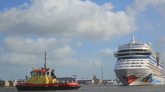 Pan shot of ships on Amstel River in Amsterdam Stock Footage