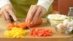 Female hands slicing carrot, dolly shot - stock footage