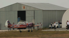 Yakovlev Yak-52 aircraft goes to the runway Stock Footage