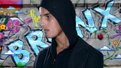 Ghetto boy over graffiti wall background Stock Footage