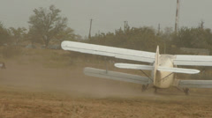 Antonov An-2R takes place on the airfield raising clouds of dust Stock Footage