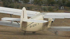 Antonov An-2R turning on the airfield raising clouds of dust Stock Footage