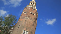Low angle dutch tilt of a Montelbaastoren Tower in Amsterdam Stock Footage