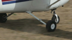 White light aircraft  driving on the field. Clos up of the wheels. Stock Footage