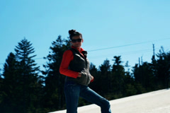 Young woman standing on a ski slope and smiling to the camera Stock Footage