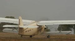 Antonov An-2R aircraft rides on the air field Stock Footage