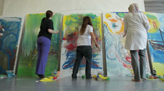 People draw on huge canvases in studio. Stock Footage