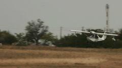 Aeroprakt A-24 Viking aircraft landing on the airfield Stock Footage
