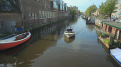 High angle of a boat sailing through water channel in Amsterdam Stock Footage