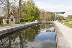 lock chamber of sluice and drawbridge - stock photo