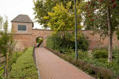 historic town wall with watchtower and gate - stock photo