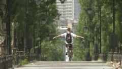 Young cyclist riding along the Avenue Stock Footage