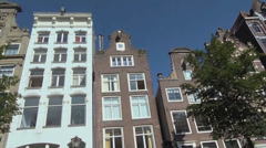 Low angle of traditional Dutch houses in Amsterdam Stock Footage