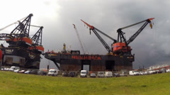 Thialf maintenance platform (DCV) and Hermod  (SSCV) moored in Calandkanaal Stock Footage