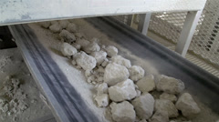 Rolling of rocks on a conveyor Stock Footage