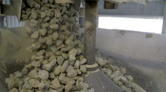 Rocks dropping from a conveyor Stock Footage