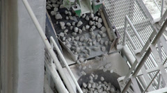 Rocks slowly dropping from a conveyor Stock Footage