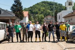 group of people helping in maglaj after flood natural disaster - stock photo