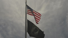 American Flag and P.O.W. flag Stock Footage