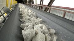 Big stones on belt of a conveyor Stock Footage