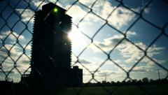 Building Silhouette Fence Afternoon Time Lapse Stock Footage