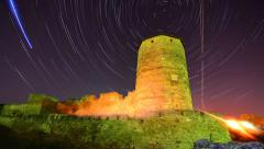Old stone tower on starry night skyes background - startrail timelapse Stock Footage
