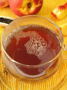 Black tea with peach and nectarine - stock photo