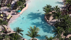 Stock Video Footage of Bahamas Atlantis pool birds eye 1