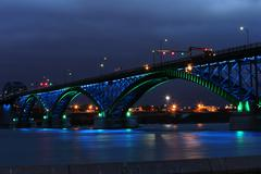 Peace bridge with green and blue lights Stock Photos