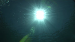 Underwater sun rays move in beautiful blue waters Stock Footage