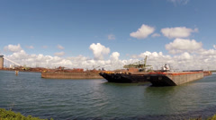 Vehicle shot barges Hartelhaven, deepsea unloading berth for sea-going vessels. Stock Footage
