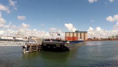 PORT OF ROTTERDAM -  Vehicle shot barges at Hartelhaven, deepsea unloading berth Stock Footage