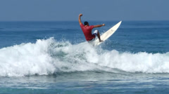 Stock Video Footage of surfer riding near the coast of Sri Lanka